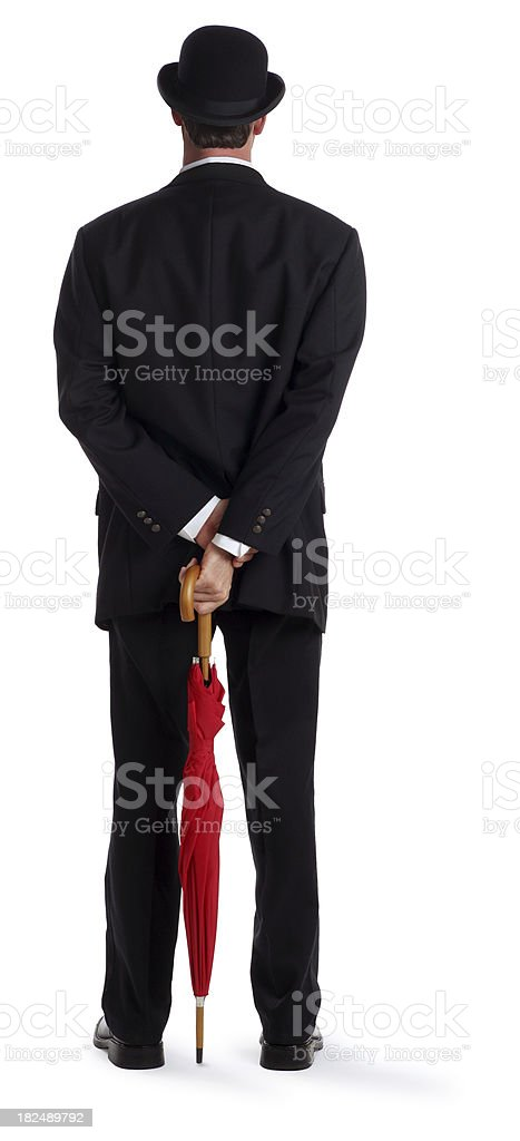 Back View of a Business Man Holding an Umbrella royalty-free stock photo
