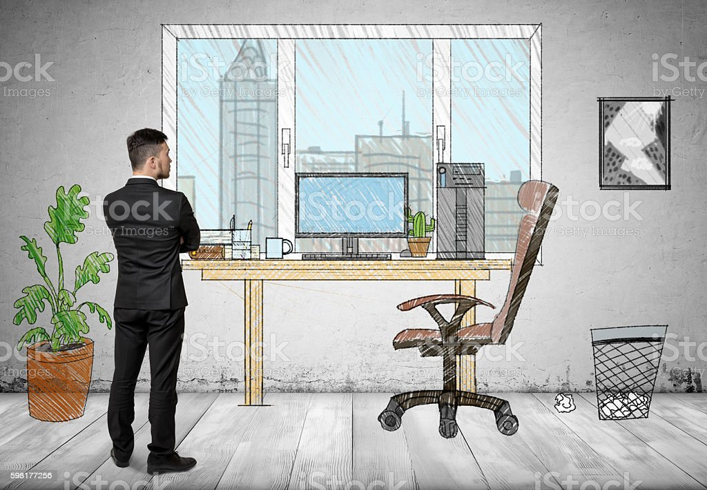 Back view of a businessman standing in hand drawn office stock photo