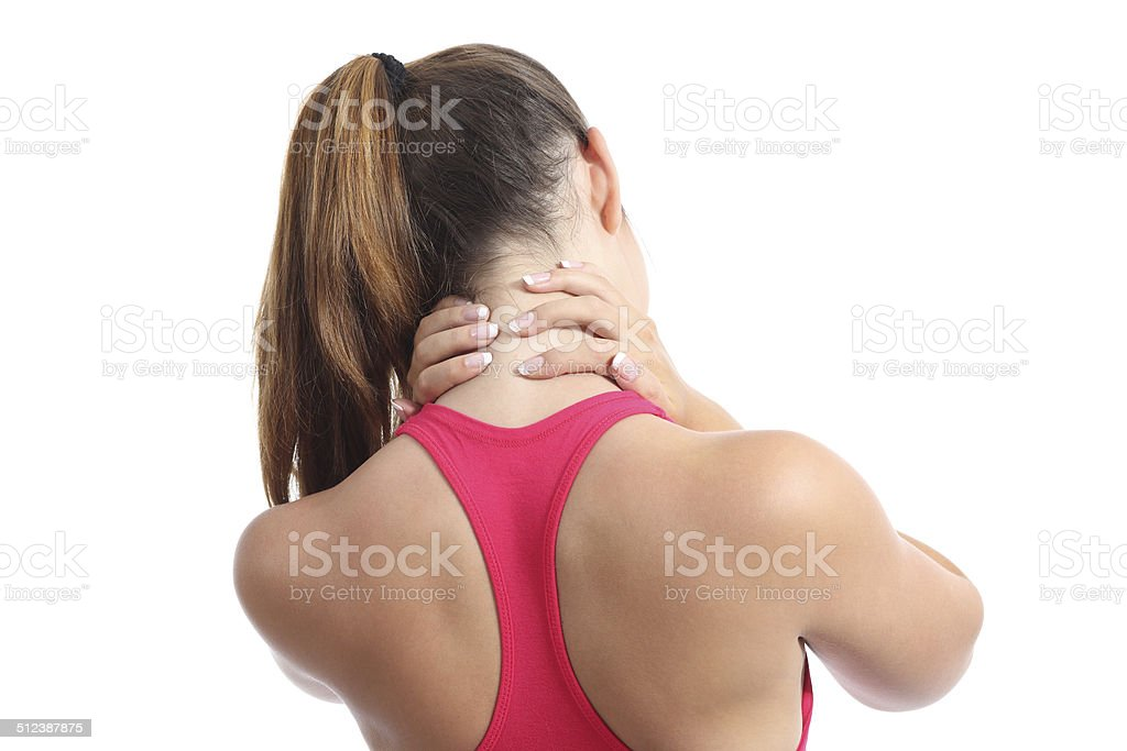 Back view of a fitness woman with neck pain stock photo