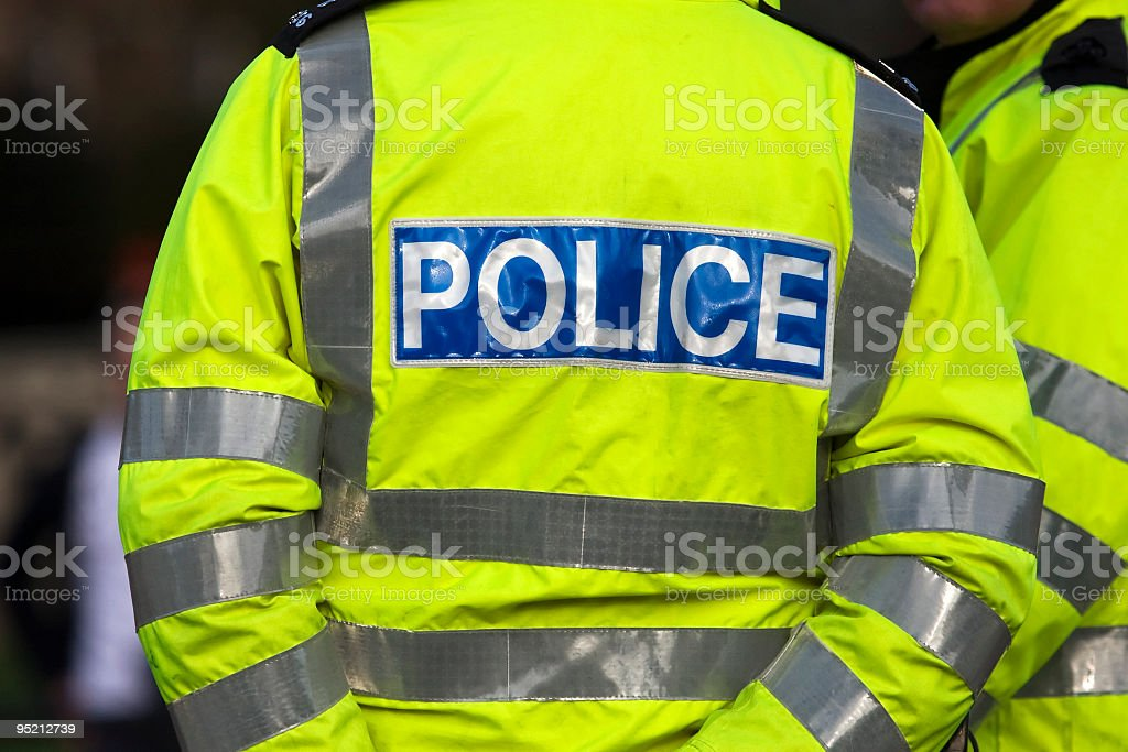 Back view of a police officer in reflexive jacket stock photo