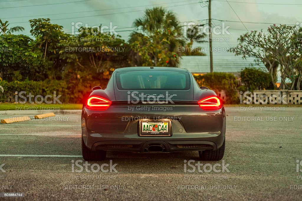 Back view of a Porsche Cayman with back lights on stock photo