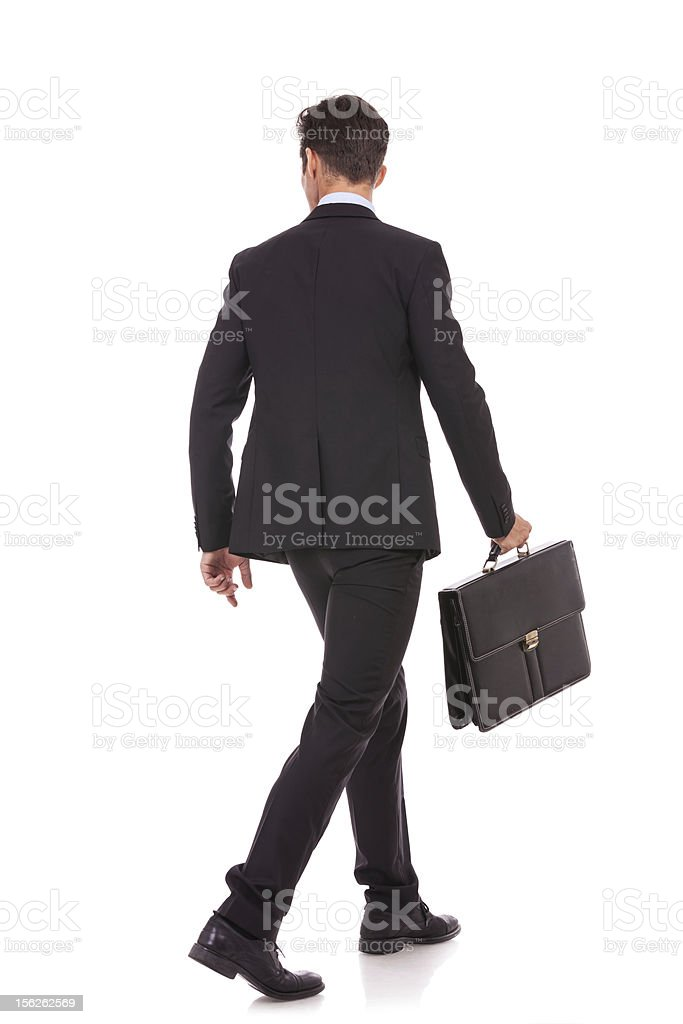 back view of a walking business man with briefcase stock photo