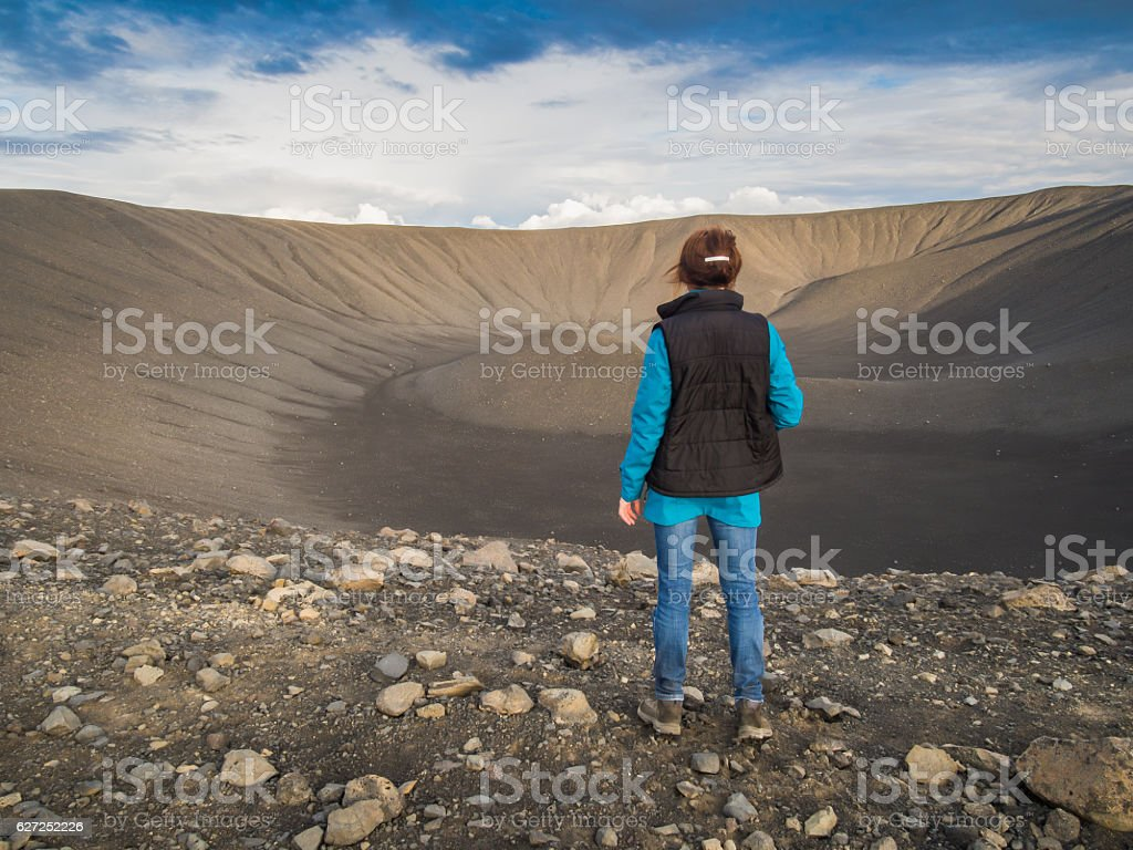 Back view of a woman in front of a volcano stock photo
