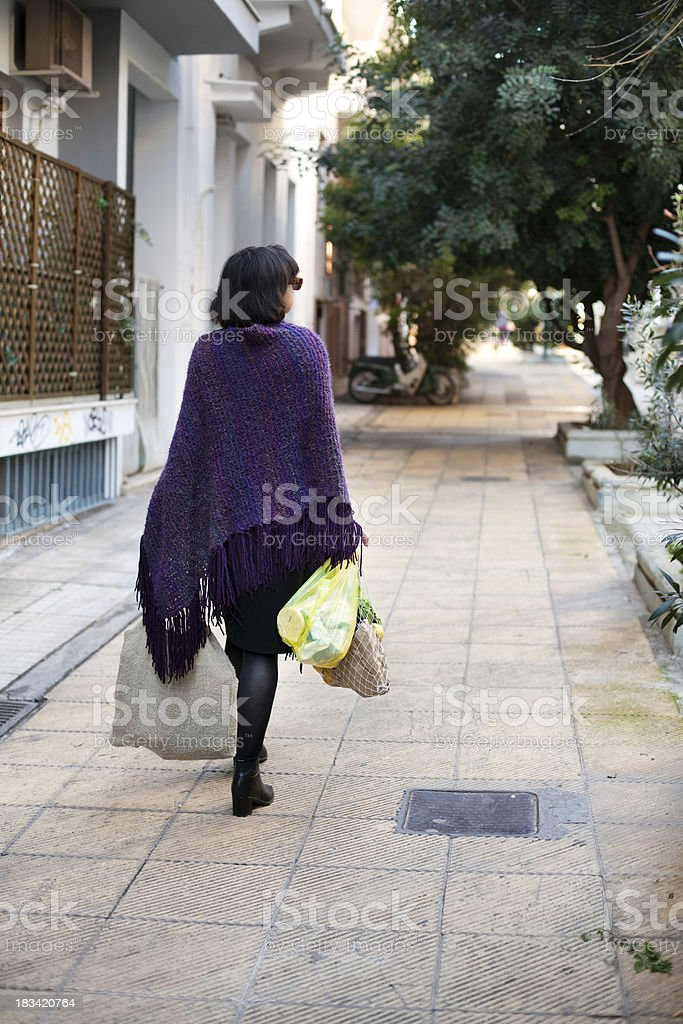 Back view of a woman walking stock photo