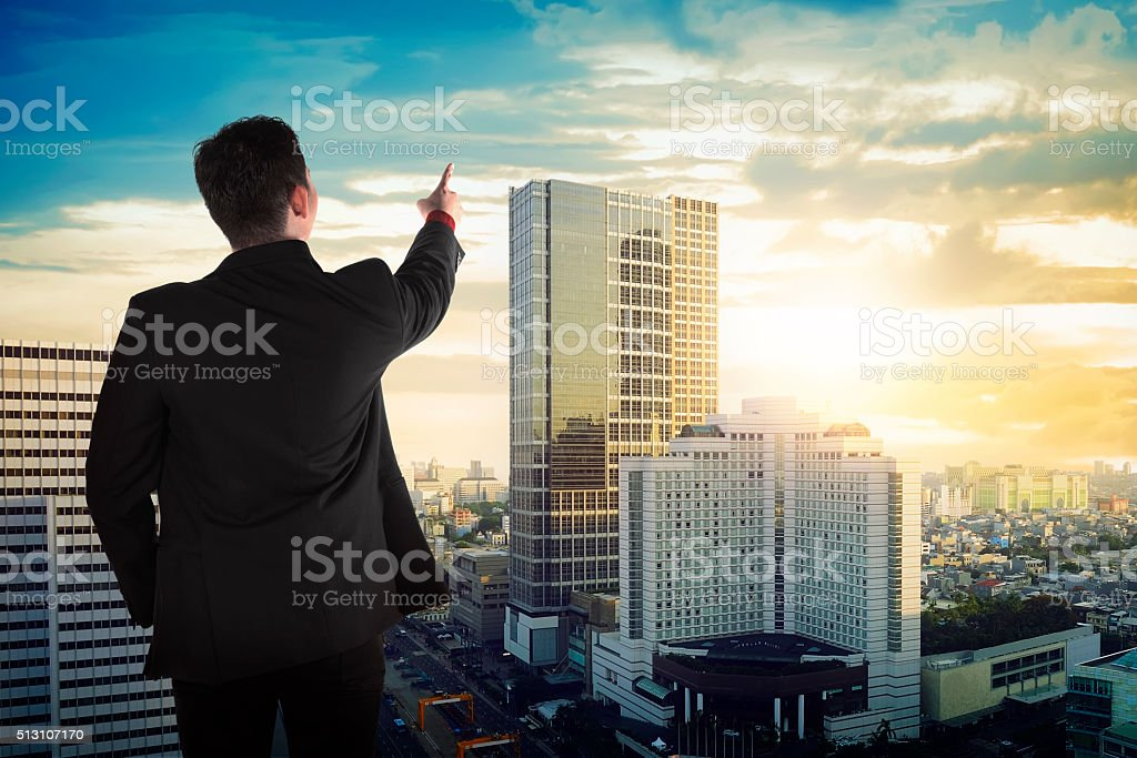 Back view of asian business man looking the sky stock photo