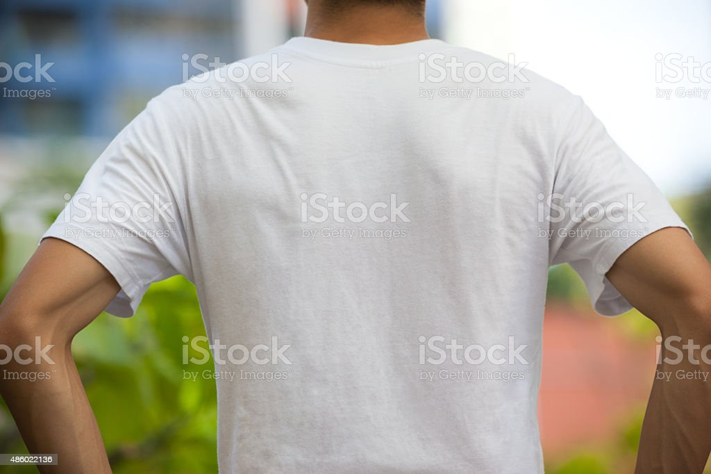 Back View of Blank White T-shirt on a Man stock photo