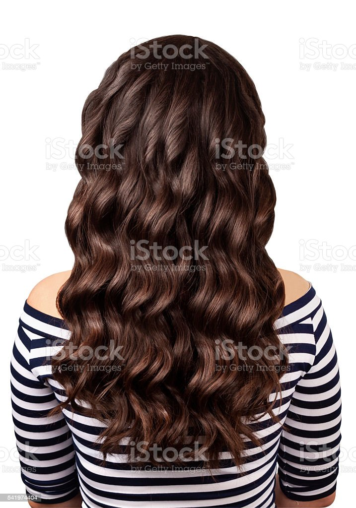 Back view of brunette woman with long dark curly hair stock photo