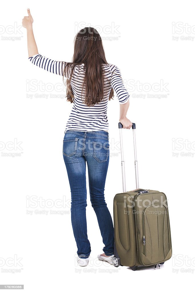 Back view of brunette woman with suitcase thumbs up royalty-free stock photo