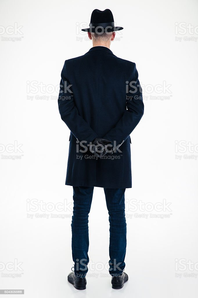 Back view of business man in black clothes and hat stock photo