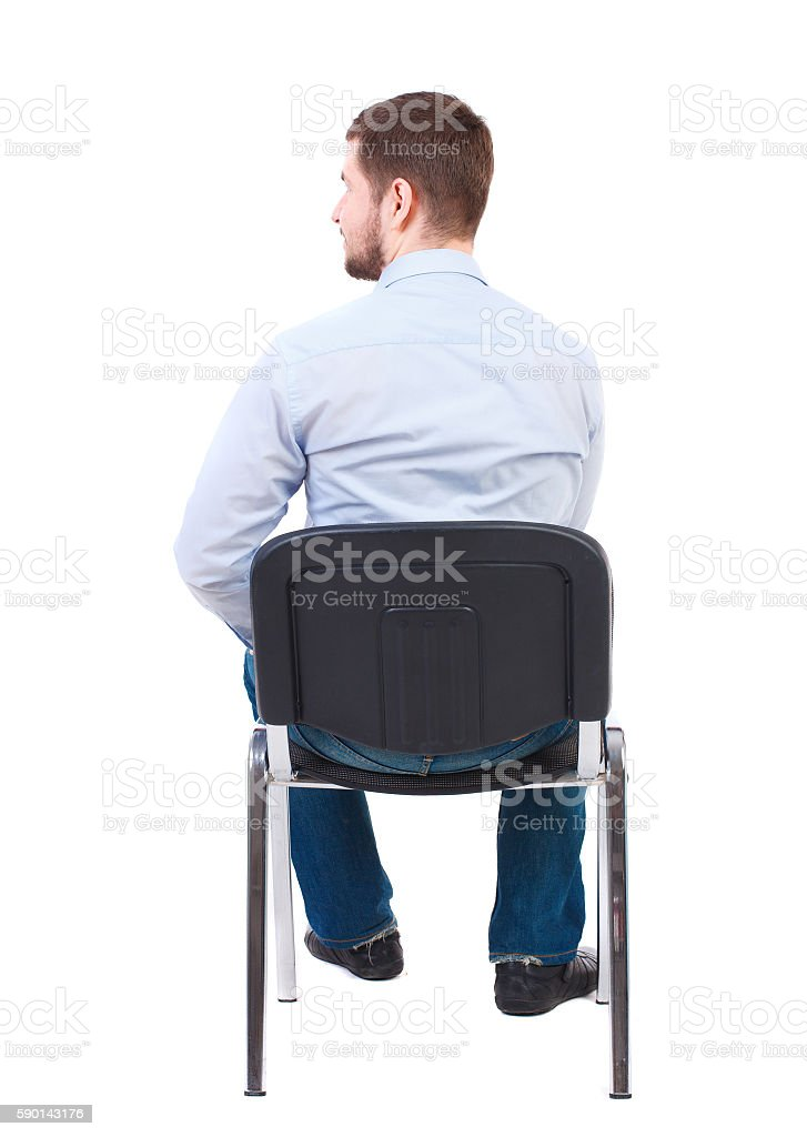 back view of business man sitting on chair. stock photo
