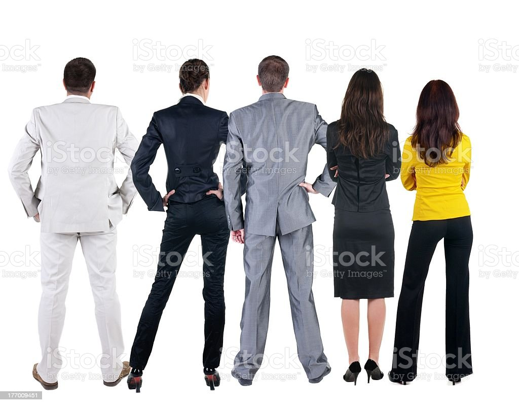 Back view of business people looks at wall royalty-free stock photo