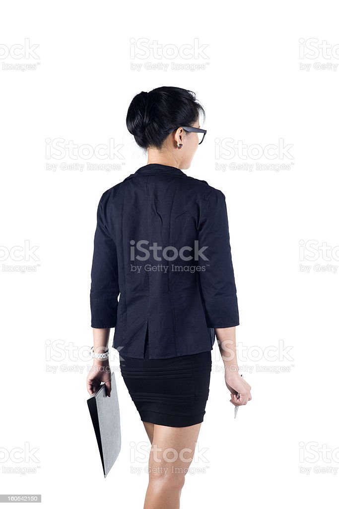 Back view of business woman holding folder and pen. royalty-free stock photo