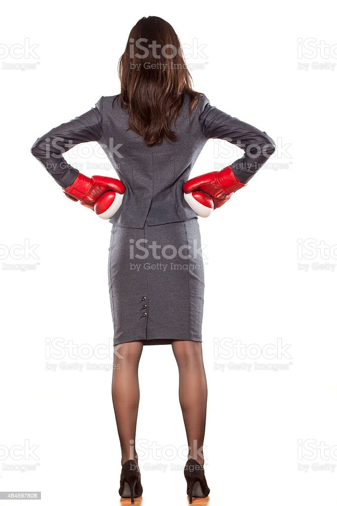 Back view of business woman with boxing gloves on white stock photo
