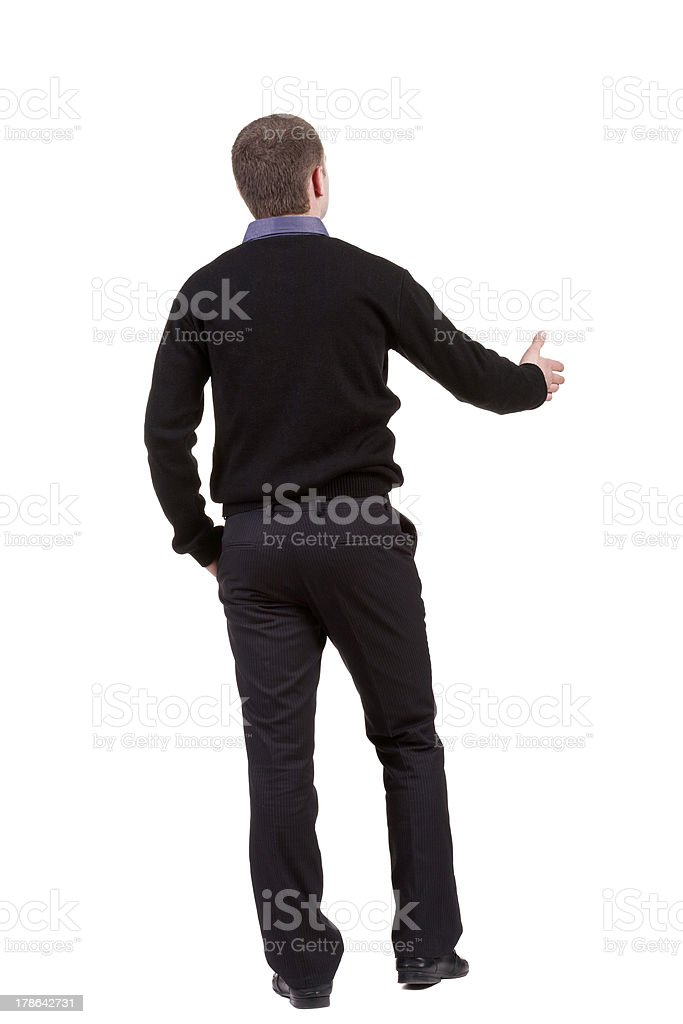 back view of businessman  reaches out to shake hands royalty-free stock photo