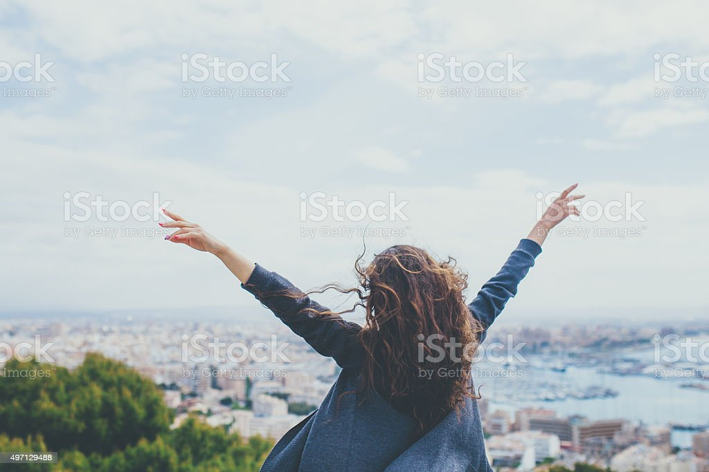 Back view of cheerful young woman stock photo