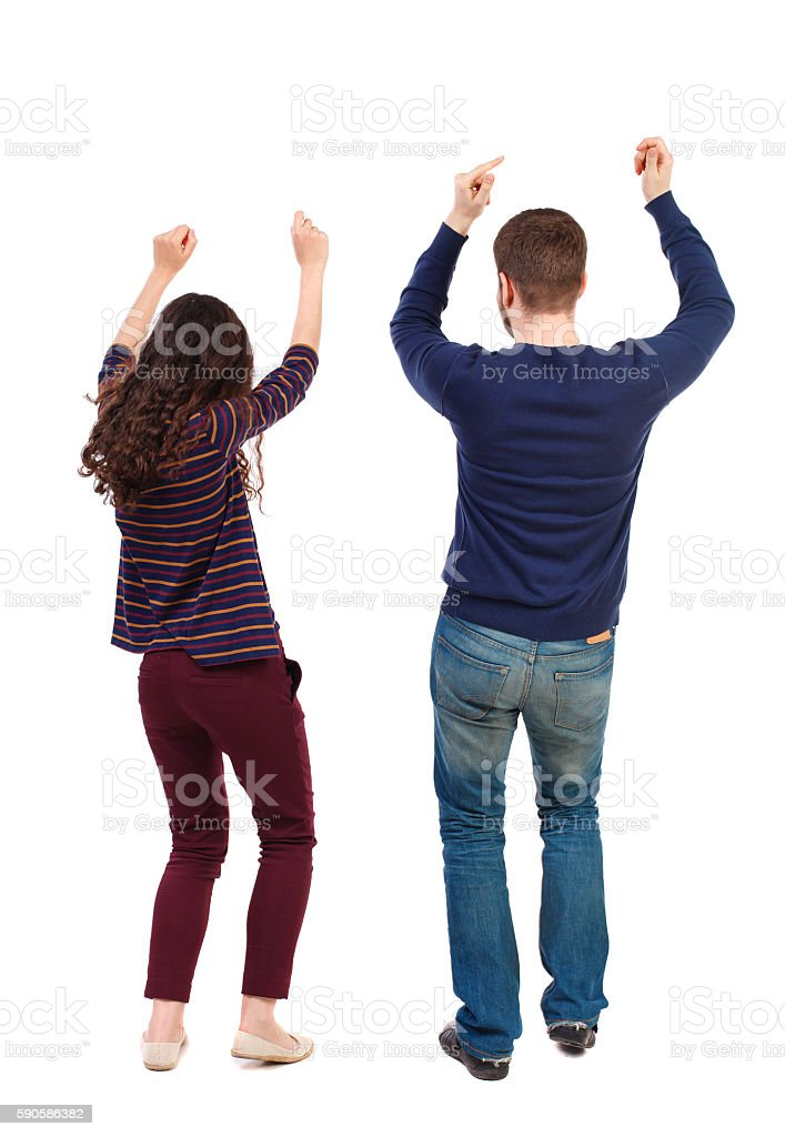 Back view of dancing young couple. Dance party. stock photo