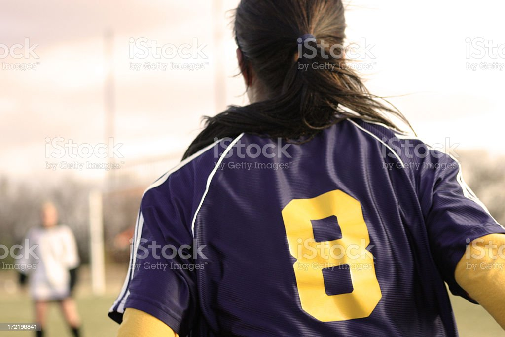 Back view of female soccer player in number 8 jersey royalty-free stock photo