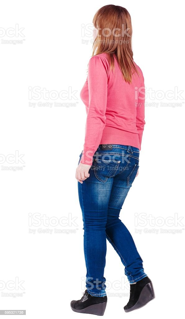 back view of going brunette girl in red stock photo