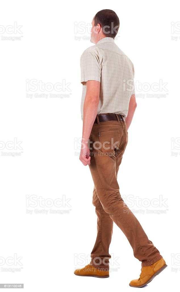 Back view of going  handsome man in jeans and a stock photo