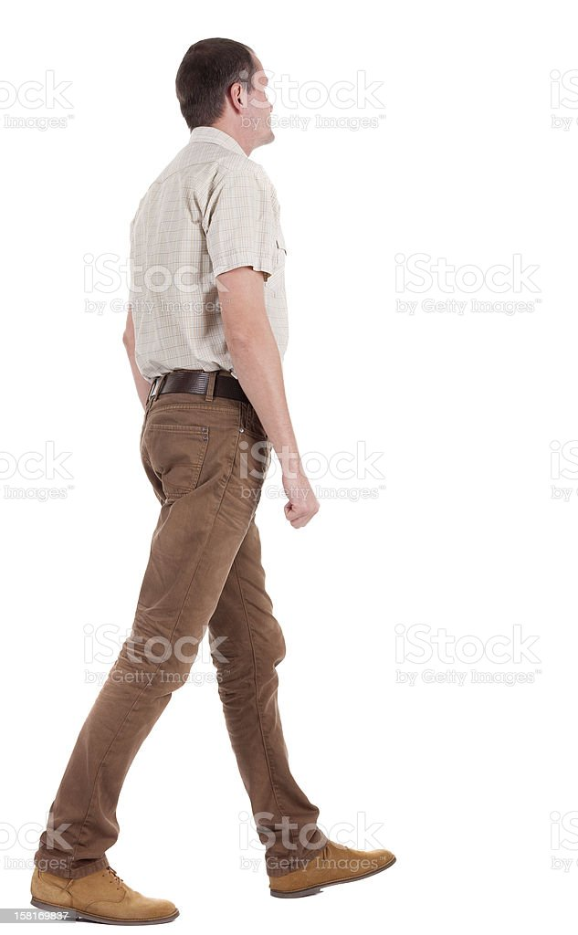 Back view of going  handsome man in jeans and shirt royalty-free stock photo