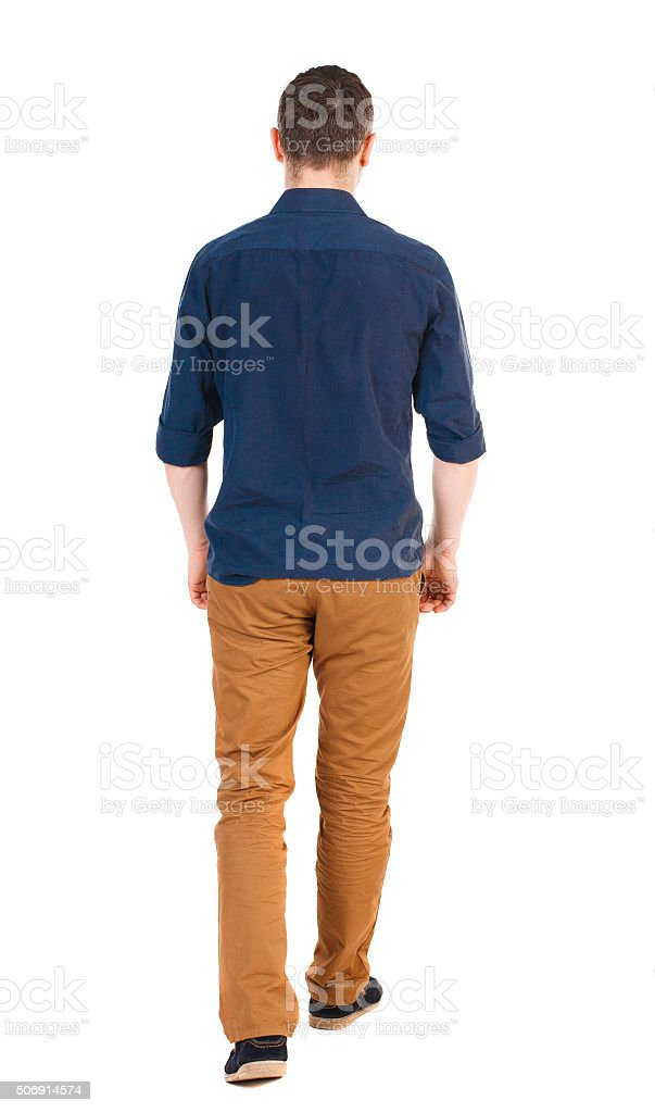 Back view of going  handsome man in jeans stock photo