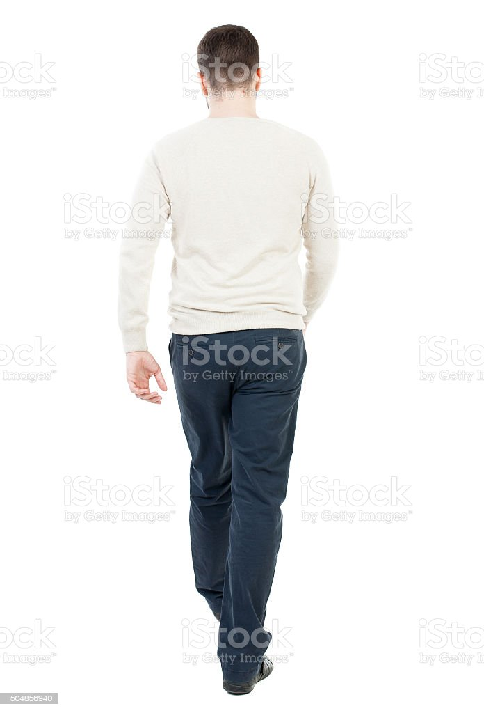 Back view of going  handsome man stock photo