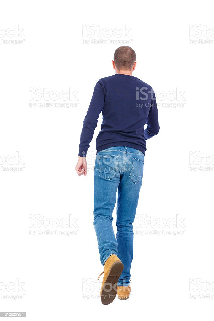 Back view of going  handsome man. stock photo