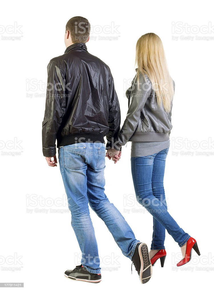 Back view of going young couple royalty-free stock photo