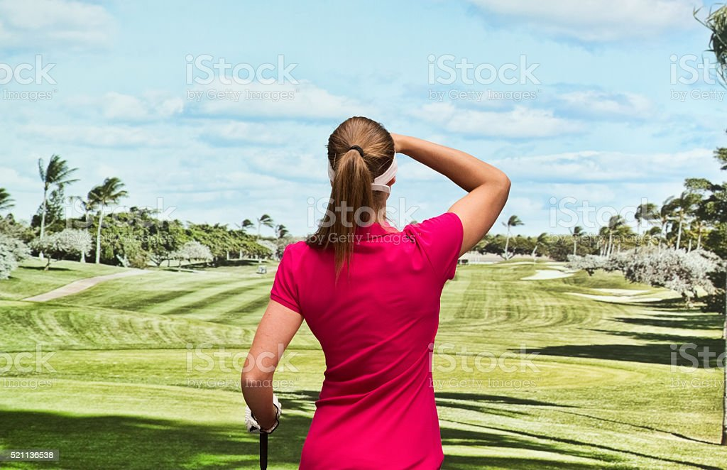Back view of golf player stock photo
