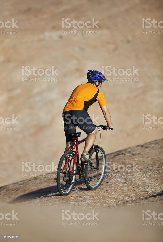 Back View Of Male Cyclist Riding Mountain Bike royalty-free stock photo