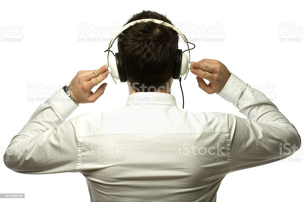 Back view of male in a white polo performing sound check stock photo