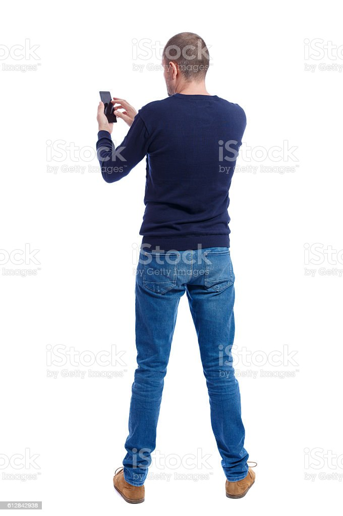 back view of man in suit  talking on mobile phone. stock photo