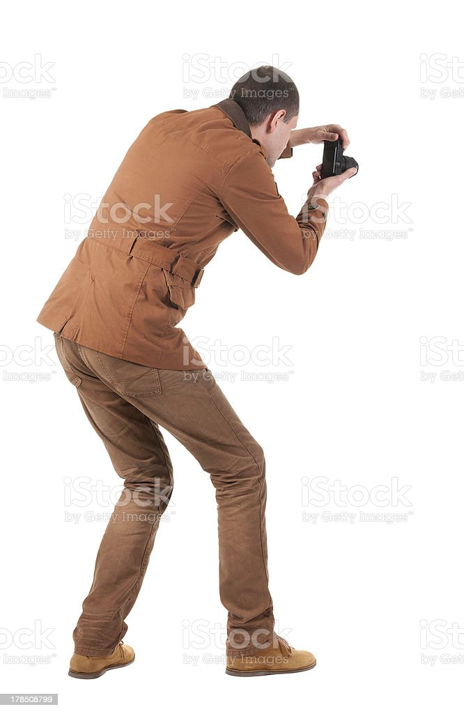 Back view of man photographing royalty-free stock photo
