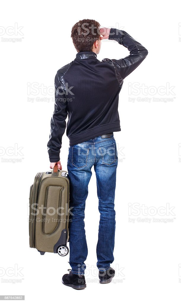 Back view of man with  green suitcase looking up. stock photo