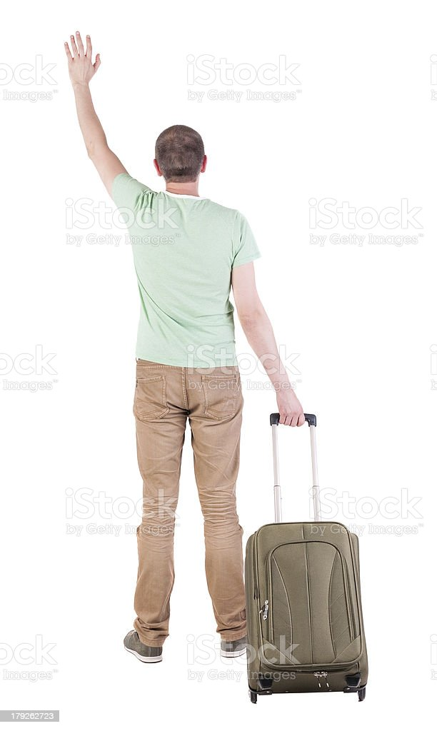 back view of  man  with suitcase. royalty-free stock photo