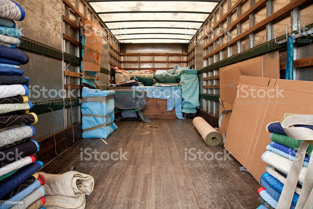 Back view of moving van looking forward, room to load stock photo