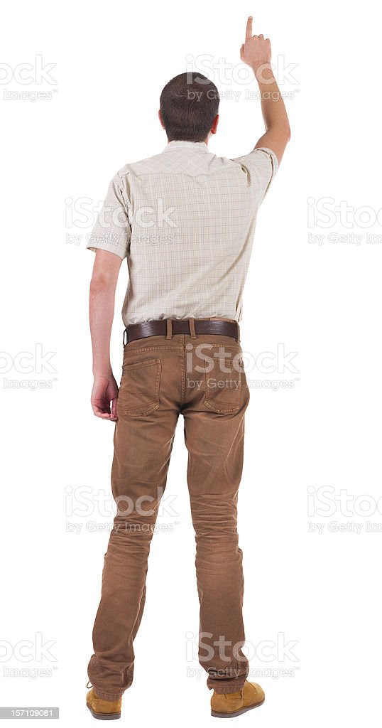 Back view of  pointing young men in  shirt and jeans royalty-free stock photo