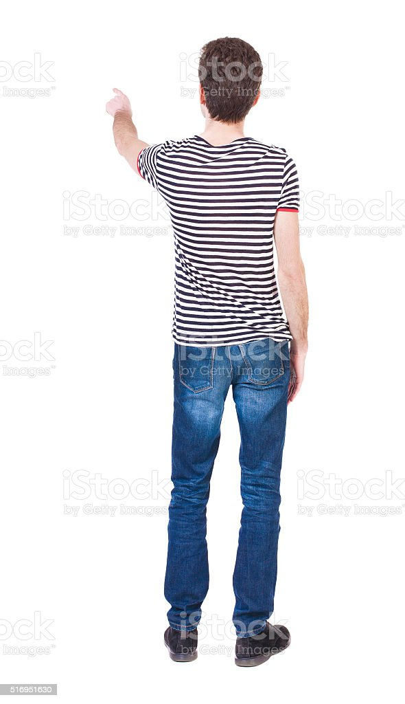 Back view of  pointing young men in  shirt and jeans stock photo