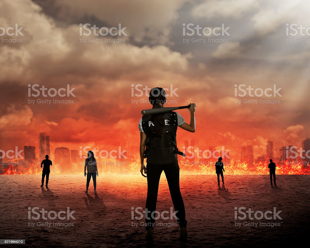 Back view of police woman ready to fight zombie stock photo