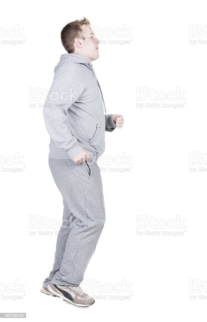 back view of running athlete man in tracksiut . royalty-free stock photo