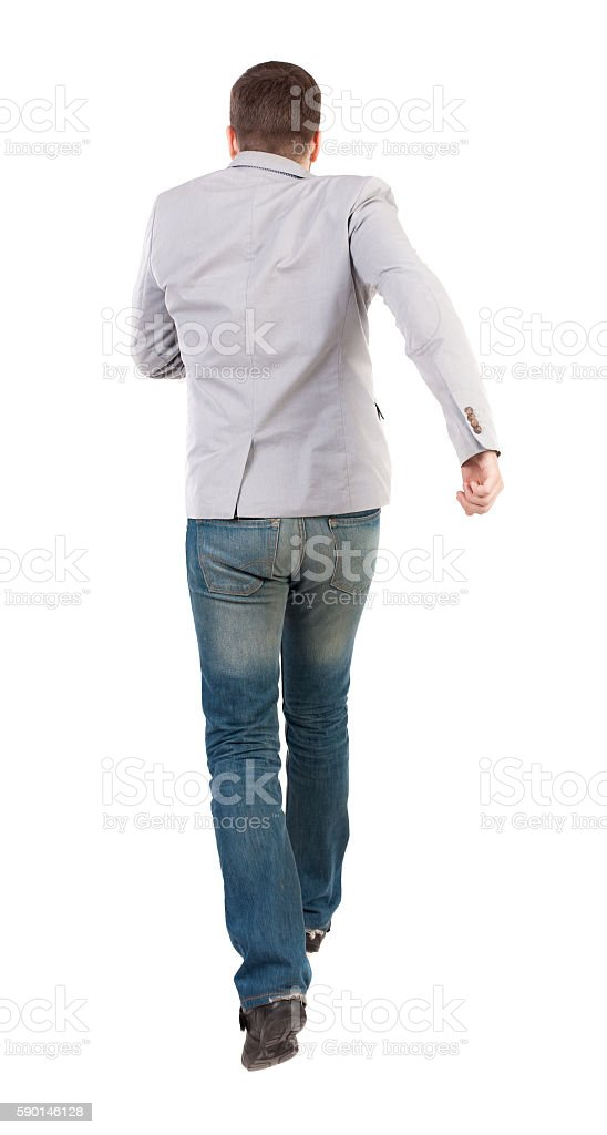 Back view of running business man. stock photo