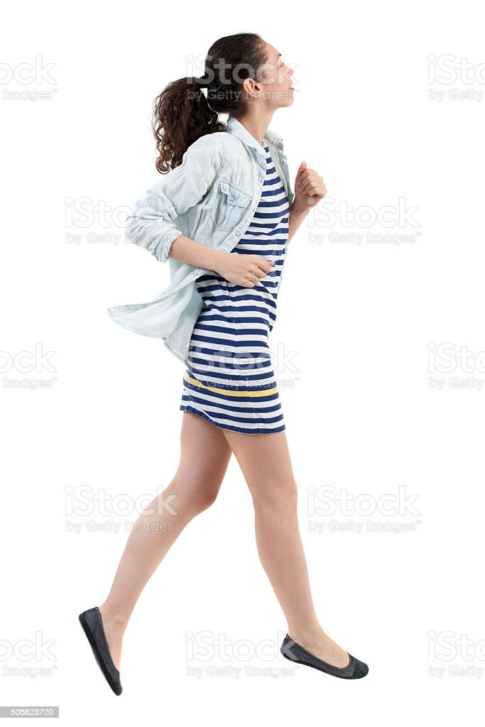 back view of running  woman stock photo