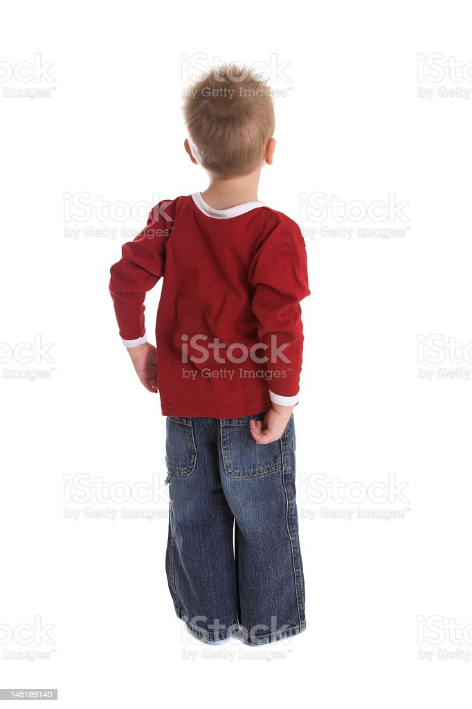Back view of small blonde boy looking off into the distance royalty-free stock photo