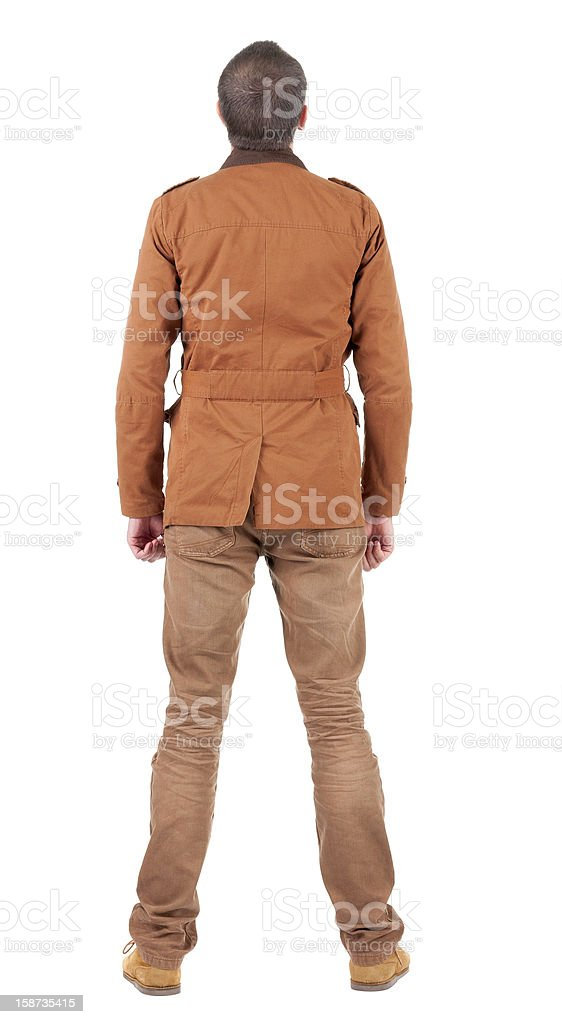 Back view of stylishly dressed man in brown jackett  looking royalty-free stock photo