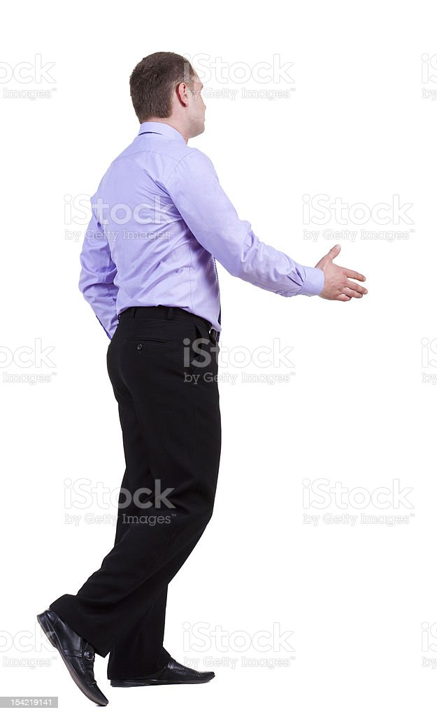 back view of walking business man hand shake royalty-free stock photo