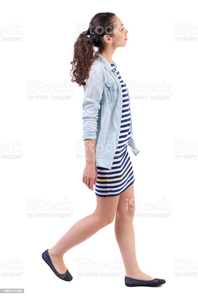 back view of walking  curly woman. stock photo