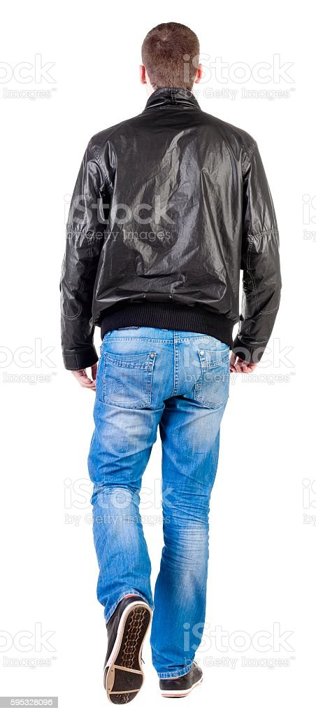 Back view of walking handsome man in jacket stock photo