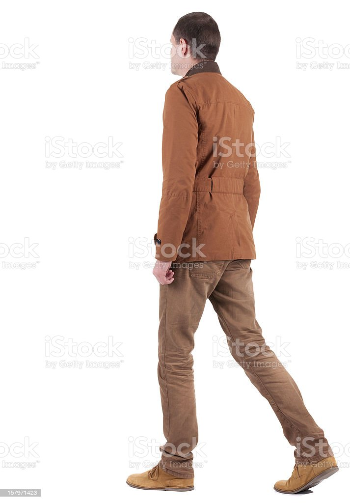 Back view of walking  handsome man in jeans and jacket. royalty-free stock photo