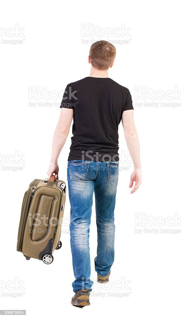 back view of walking  man  with suitcase. stock photo