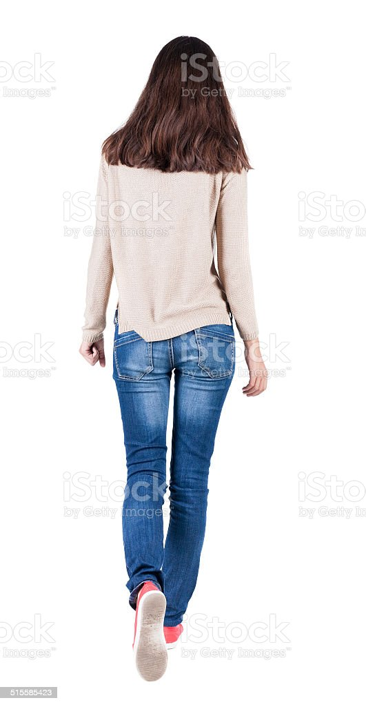 back view of walking  woman in jeans . stock photo